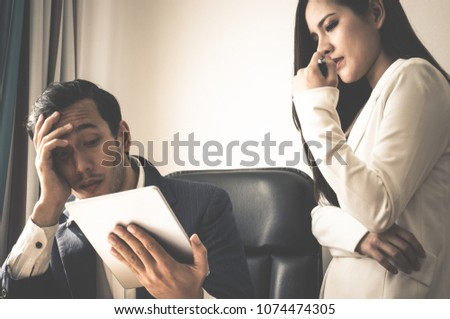 Boss and secretary is stress out with report on tablet #1074474305