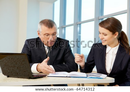 Boss and secretary planning work in office