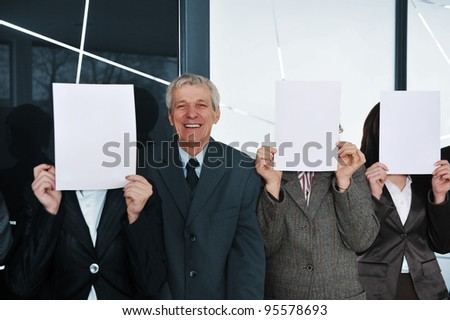 Boss and three businesswoman holding white papers