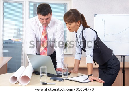 Boss and woman working in office