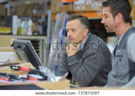 boss and worker checking results on pc #737871097