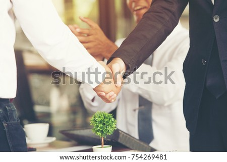 Boss encourages subordinates.business people handshaking congratulate the promotion of hiring a marketing consultant to get a higher salary.Concept Business Partners team to compete with competitors.
