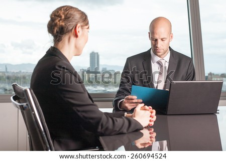 Boss evaluates a female worker