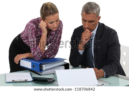 Boss explaining point to colleague