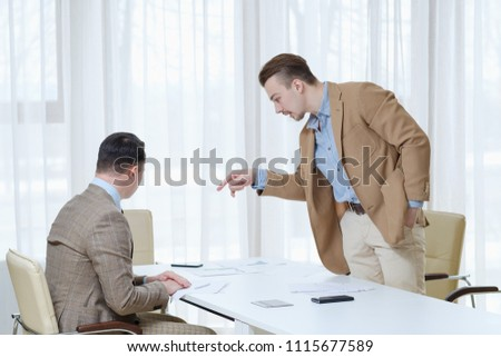 boss giving instructions to his subordinate employee. business communication. office workspace