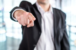 Boss giving order or firing employee. Powerful business man pointing camera with finger. Angry executive or manager. Tough leadership, strict discipline, workplace bullying or fight at work.