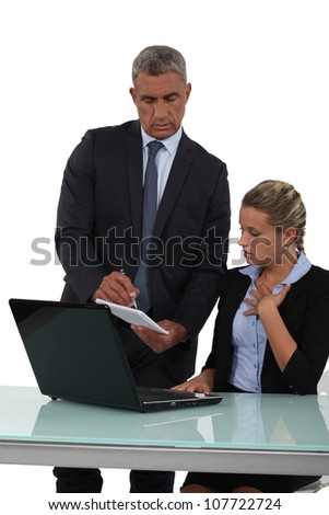 Boss handing note to young assistant