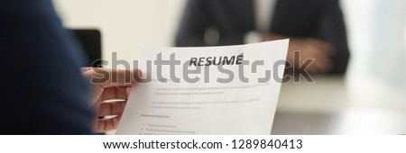 Boss hr manager holds resume cv paper close up, interviewing vacancy candidature panoramic image, human resources headhunt new job employment concept. Horizontal photo banner for website header design
