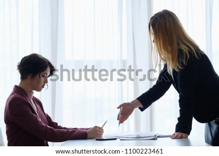 boss reproaching her employee. business woman getting a reprimand from chief manager. superior and subordinate professional relationship.