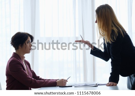 boss reproaching her employee. business woman getting a reprimand or reproof chief manager. superior and subordinate professional relationship.
