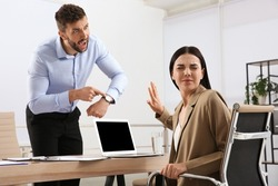 Boss screaming at employee in office. Toxic work environment