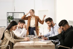 Boss screaming at employees in office. Toxic work environment