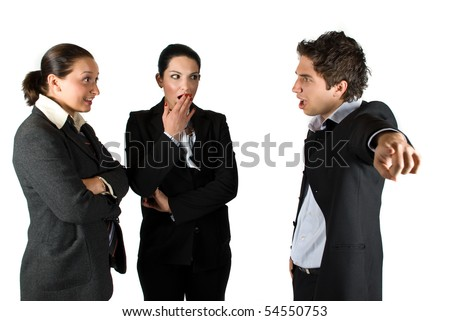 Boss screaming :You are fired! and pointing out at two employees ,the brunette businesswoman it is shocked and surprised and put her hand at mouth and the other making a smiley face like she say:What? - stock photo