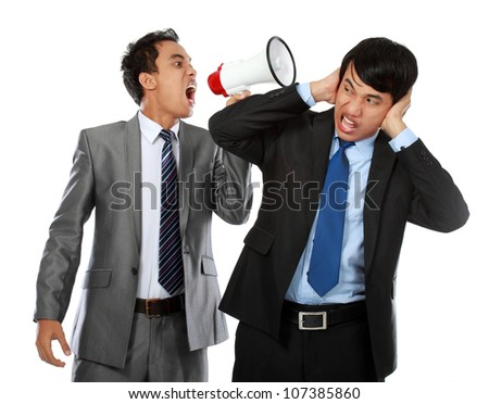 boss shouting over his employees ear, using megaphone isolated over white background