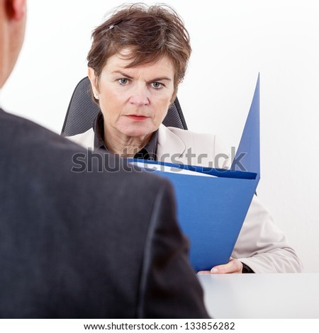 Boss talking to candidates