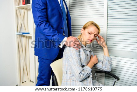 Boss touch shoulder of female office colleague. Tired woman worker relaxing while man massaging her. Behavior rule and subordinate at work. Boss unacceptable behavior with subordinate employee.