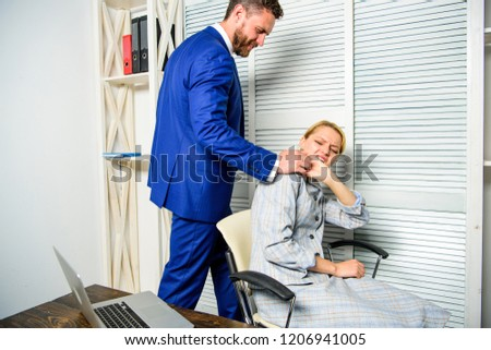 Boss unacceptable behavior with subordinate employee. Boss touch shoulder of female office colleague. Tired woman worker relaxing while man massaging her. Behavior rule and subordinate at work.