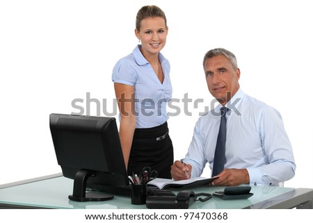 Boss working with female assistant