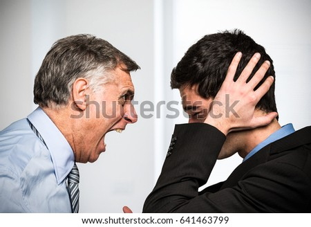 Boss yelling to an employee #641463799