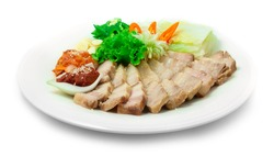 Bossam Korean Boiled Pork wraps Served Chili Spicy Kochujung Sauce, Kimchi,Green Chili, Garlic, onion and Chinese Cabbage  Food Style decorate with carved Leek and vegetable sideview
