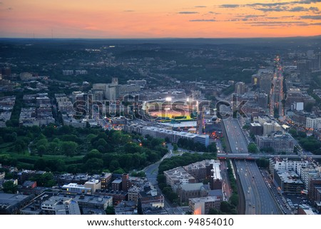 Boston aerial view at sunset with cityscape and buildings.