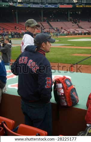 BOSTON - APRIL 7: A man boosts his son up to see players practicing before the game at the Boston Red Sox Opening Day at historical Fenway Park April 7, 2009 in Boston, Massachusetts.