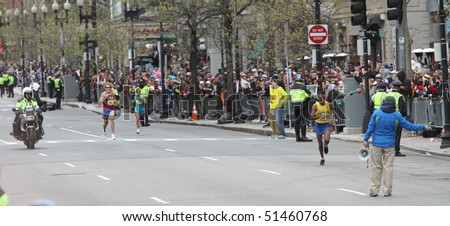 BOSTON - APRIL 19:  Deriba Merga (ETH) [Far Right] leads Ryan Hall (US) [Left] near finish of Boston Marathon on April 19, 2010 in Boston, MA.  Legese (Center) finished in 15th place for women.