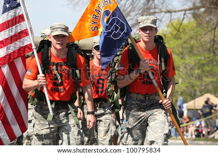 BOSTON - APRIL 16 : Fans cheer on Syracuse ROTC marching the boston marathon in full 40 lb ruck-sacks during the Boston Marathon April 16, 2012 in Boston.