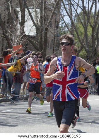 BOSTON - APRIL 21: Nearly 36000  runners participated in the Boston Marathon on April 21, 2014 in Boston. Meb Keflezighi (USA) finished first with a time of 2:08:37. - stock photo