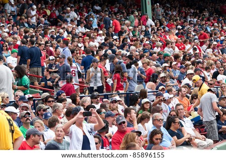 Boston - August 8: New York Yankees and Boston Red Sox fans in the stands on August 8, 2011 at Fenway Park in Boston, Massachusetts.