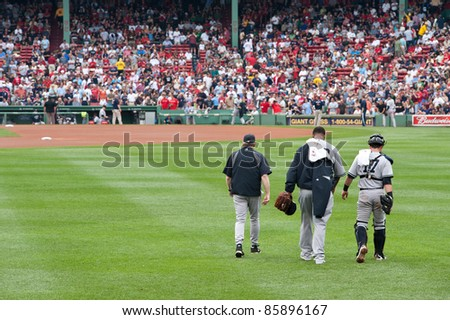 Boston - August 8: New York Yankees starting pitcher, #52, C.C. Sabathia and catcher, #17, Francisco Cervelli make their way to the mound on August 8, 2011 at Fenway Park in Boston, Massachusetts.