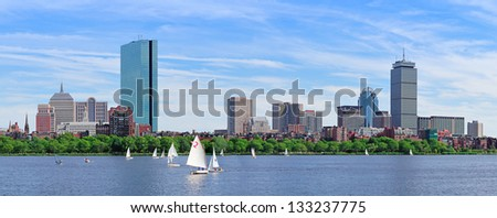 Boston Charles River panorama with urban city skyline skyscrapers and boats with blue sky. - stock photo