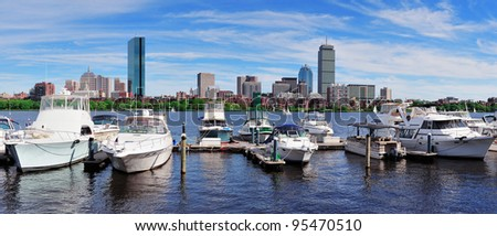 Boston Charles River panorama with urban city skyline skyscrapers and boats with blue sky over Charles River.
