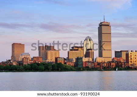 Boston city skyline with Prudential Tower and urban skyscrapers over Charles River.