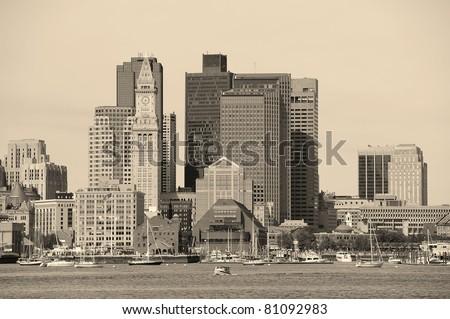 Boston downtown architecture closeup in black and white over sea.