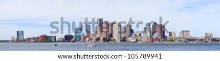 Boston downtown skyline in the morning with urban skyscrapers over sea.