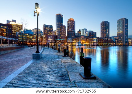 Boston Harbor and Financial District at sunset in Boston, Massachusetts.