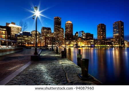 Boston Harbor and Financial District in Boston, Massachusetts at Sunset.