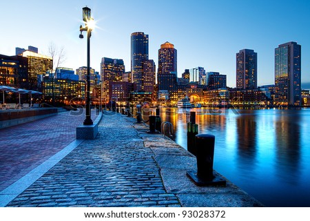Boston Harbor and Financial District in Boston, Massachusetts in the sunset.
