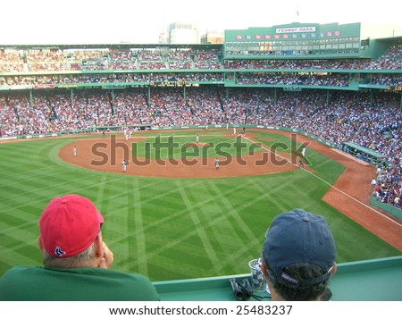 Boston - July 2008: Watching a Red Sox game at historic Fenway Park from Green Monster in left field in July 2008.
