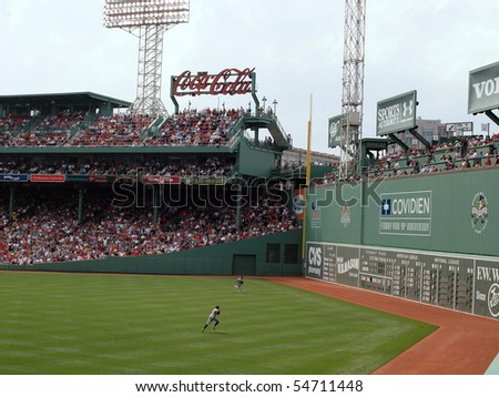 BOSTON - JUNE 3: Red Sox vs Athletics: A's outfielders chase down a fly ball at Fenway.  taken June 3, 2010 Fenway Park Boston, Massachusetts from the bleachers . - stock photo
