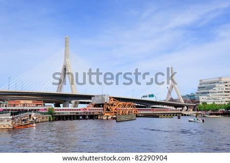 Boston Leonard P. Zakim Bunker Hill Memorial Bridge with blue sky as the famous land mark over Charles River.