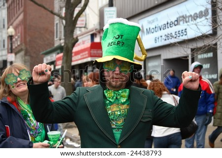 BOSTON, MASSACHUSETTS - MARCH 16: An unidentified man wearing a green suit and showing the spirit of the Saint Patrick's parade. The event was held in Boston, Massachusetts on March 16, 2008.
