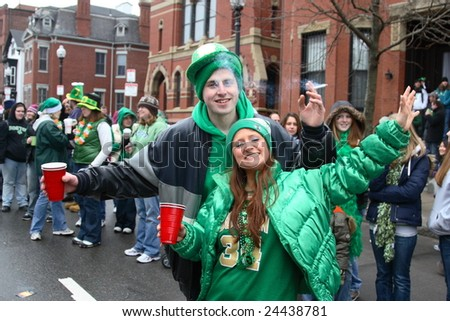 BOSTON, MASSACHUSETTS - MARCH 16: Two unidentified young people joyfully celebrate in  the street during the Saint Patrick's day parade held in Boston, Massachusetts, March 16, 2008.