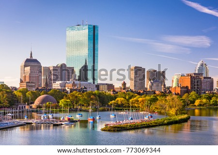 Boston, Massachusetts, USA city skyline on the river.