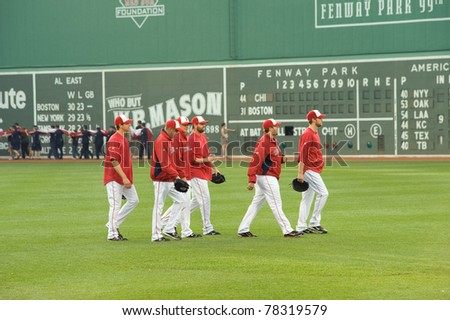 BOSTON - May 30:  Boston Red Sox relief pitchers head to the bullpen before Memorial Day game at historical Fenway Park on May 30, 2011 in Boston, Massachusetts.