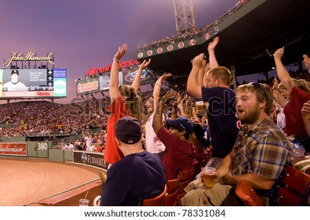Boston - May 30: Fans cheer at historic Fenway Park during Memorial Day game against the Chicago White Sox May 30, 2011 in Boston, Massachusetts.