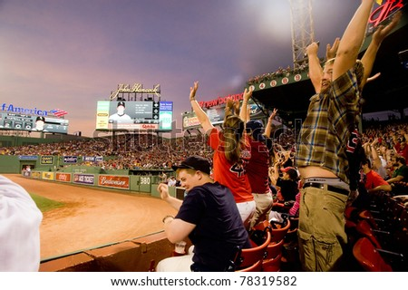Boston - May 30: Fans do the wave at historic Fenway Park during Memorial Day game against the Chicago White Sox on May 30, 2011 in Boston, Massachusetts.