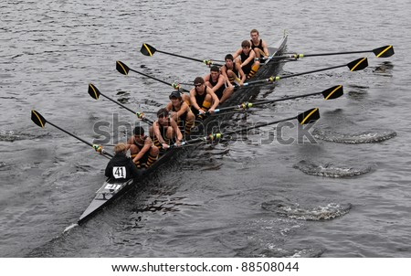 BOSTON - OCTOBER 23: McQuaid Jesuit Crew youth men's Eights races in the Head of Charles Regatta. Marin Rowing Association won with a time of 15:06 on October 23, 2011 in Boston, MA. - stock photo