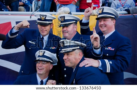 BOSTON - OCTOBER 16: Members of US Coast Guard wearing uniform pose for picture at Gillette Stadium, New England Patriots vs. the Dallas Cowboys on October 16, 2011 in Foxborough, Boston, MA